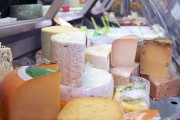a cheese display at a dairy products store