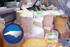 north-carolina map icon and a cheese display at a dairy products store