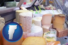 vermont map icon and a cheese display at a dairy products store