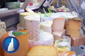 a cheese display at a dairy products store - with New Hampshire icon