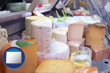 a cheese display at a dairy products store - with Wyoming icon